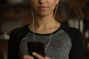 Woman listening music while using phone