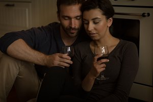 Couple having wine while sitting at home