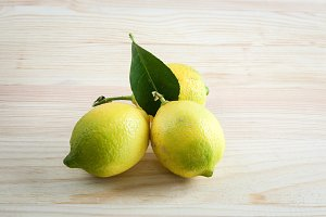 Lemons on wooden table with checkere