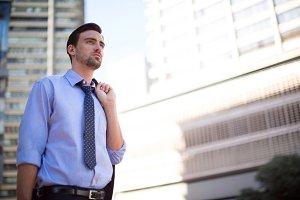 Businessman standing near office building