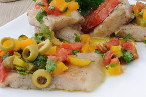 Fillet of fish under vegetables