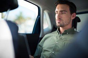Man using laptop in car
