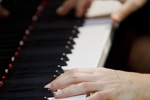 Hands musician playing the piano.
