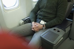 Male passenger resting in his seat while travelling in an aircraft