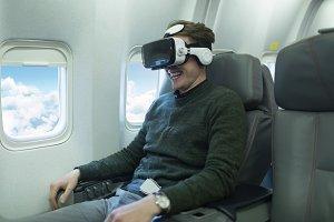 Male passenger using virtual reality headset