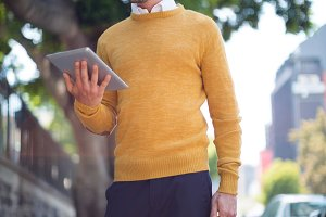 Man with briefcase using digital tablet