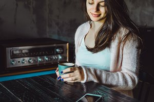 brunette girl using a smartphone