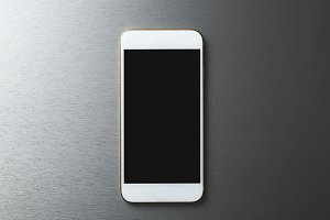Smartphone on gray background. Technology.