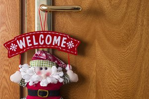 Door with welcome at Christmas