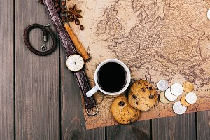 Cup of coffe on old yellow map