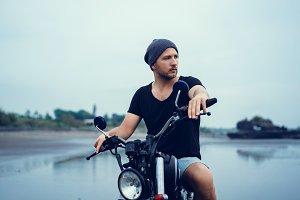Handsome beard man using motorcycle