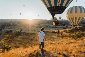 Man posing near balloon