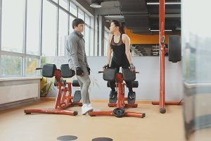 Athlete man and woman have conversation in the gym