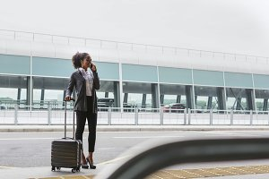 Businesswoman standing at terminal