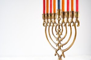 Brass hanukkah menorah with candles copy space