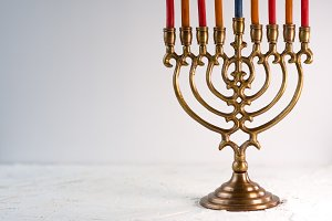 Brass hanukkah menorah with candles side view