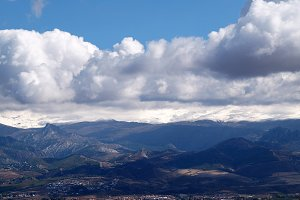 Mountains, snow and clouds