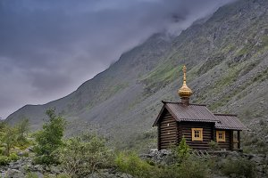 wooden Orthodox church in the mountains Altai, Russia
