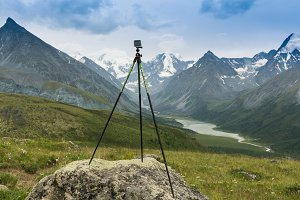 Photo camera mounted on tripod outdoors, Altai, Russia