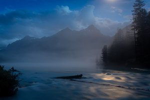 Wonderful Kucherlinsky lake At night under the moon that is at the foot of the Belukha mountain, Altai Mountains, Russia