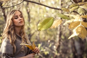 beautiful girl in autumn forest