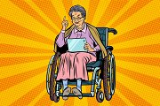 elderly woman disabled person in a wheelchair, gadget tablet