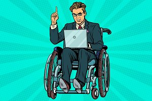 businessman in wheelchair with laptop