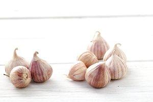 Fresh healthy garlic on white table