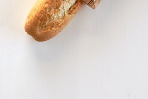 French bread baguette on wood table top white background
