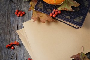Paper with leaves, pumpkin and book