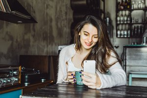 Girl coffee and smartphone