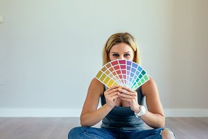 Young woman with color chart