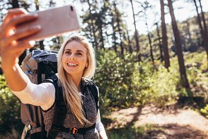 Woman hiker taking photograph