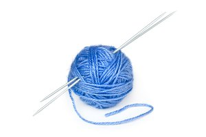 Wool yarn with knitting needles