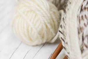 Skeins of wool and knitting needles