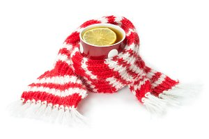 Woolen scarf and cup of tea