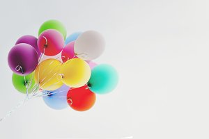 Colorful balloons against cloudy sky