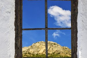 mountain behind the old window