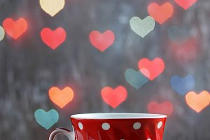 Cup of tea with heart bokeh