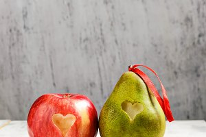 Fresh apple and pear with heart