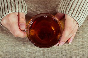 Hands with a cup of tea