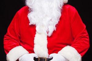 Christmas. Santa Claus portrait smiling against black background.