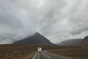 RV pick-up trailer on mountain road in Scotland