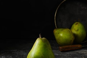 Fresh pears on dark background