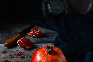 Red pomegranate on dark background