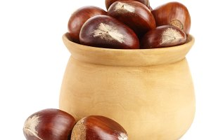 chestnut in a wooden bowl isolated on white background. Top view
