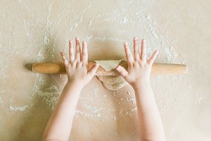 Children's hands rolled dough