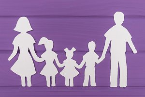 The silhouettes cut out of paper of man and woman with two girls and boy