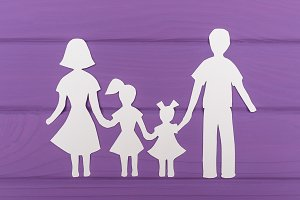 The silhouettes cut out of paper of man and woman with two girls