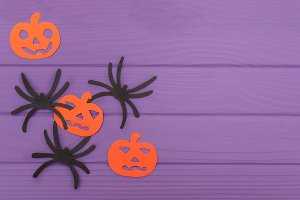 The spiders and pumpkins halloween silhouettes cut out of paper